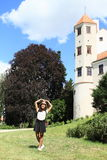 Happy girl in front of tower of castle in Telc Stock Photos