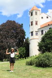 Happy girl in front of tower of castle in Telc Royalty Free Stock Photography