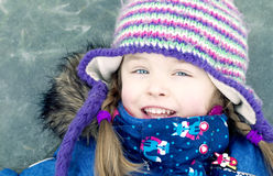 Happy girl on frozen lake royalty free stock photos