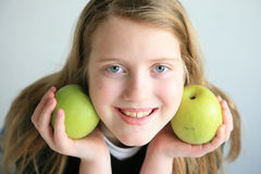 Happy girl with fruits. Happy girl with green fruits assortment, health life concept stock image