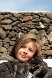 Happy girl in a fur coat Stock Images
