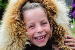 Happy Girl in Fur Hood Royalty Free Stock Photo