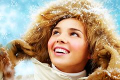 Happy girl in furry hood Stock Images