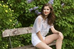 Happy girl in garden in summertime Royalty Free Stock Photos