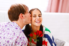 Happy girl get rose as present from her boyfriend Royalty Free Stock Image