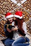 Happy Girl gets Christmas present Stock Image