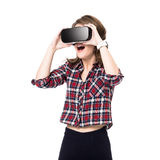 Happy girl getting experience using VR headset glasses of virtual reality, much gesticulating hands, isolated Stock Image