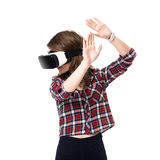 Happy girl getting experience using VR headset glasses of virtual reality, much gesticulating hands, isolated Royalty Free Stock Images