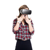 Happy girl getting experience using VR headset glasses of virtual reality, much gesticulating hands, isolated Royalty Free Stock Photography