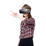 Happy girl getting experience using VR headset glasses of virtual reality, much gesticulating hands, isolated. Happy girl getting experience using VR headset stock image