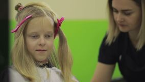 Happy girl getting a new haircut by hairdresser stock video footage