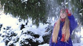 Happy girl getting a snow shower stock video