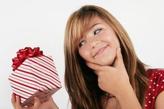 Happy girl with a gift stock image