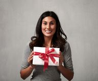 Happy girl with gift. Stock Photos