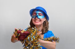 happy girl with a gift in blue Stock Photo