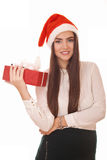 Happy girl with gift box in christmas hat Royalty Free Stock Photo