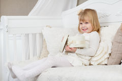 Happy girl with gift box. Royalty Free Stock Image