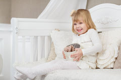 Happy girl with gift box. Royalty Free Stock Photography
