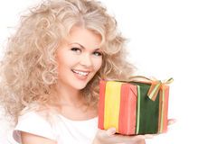 Happy girl with gift box Stock Photos
