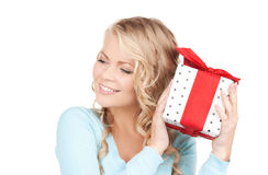 Happy girl with gift box Stock Images