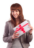 Happy girl with gift box smiling Stock Image