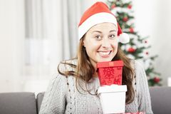 Happy girl with gift boxes for you Royalty Free Stock Photos