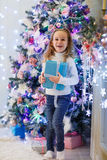 Happy girl with gift. Christmas. Stock Photos