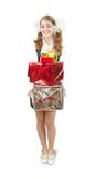 Happy girl with gifts isolated over white Royalty Free Stock Image