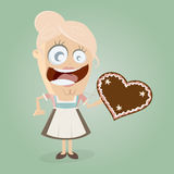 Happy girl with gingerbread heart Stock Images