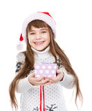 Happy girl gives a gift. isolated on white background Royalty Free Stock Photo