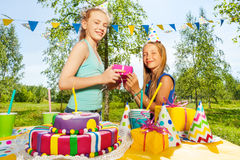 Happy girl giving birthday gift to her friend Royalty Free Stock Photography