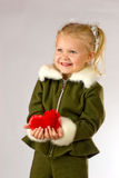 Happy girl giving her heart Stock Images