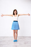 Happy girl glad to see you. Full length portrait of a young happy girl glad to see you Stock Images