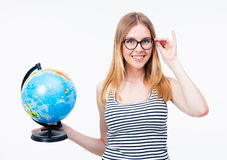 Happy girl in glasses holding world globe Royalty Free Stock Images