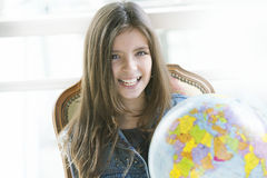 Happy girl with globe. Happy girl studying with earth globe Royalty Free Stock Photo