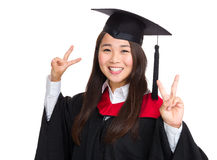Happy girl with graduation gown Royalty Free Stock Images