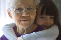 Happy girl with grandma. Girl with grandma home royalty free stock photography