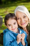 Happy Girl With Grandmother At Campsite Stock Images