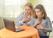 Happy girl and grandmother using a laptop. Stock Photography