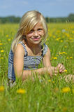 Happy girl in grass Stock Photos