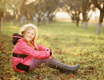 Happy girl on grass Royalty Free Stock Photography