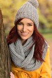 Happy girl with a gray scarf and cap Stock Photography
