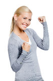 Happy female with her fists up Stock Images