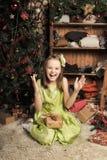 Happy girl in green dress Stock Image
