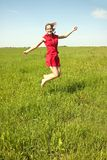 Happy girl on green field Royalty Free Stock Photography