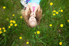 Happy girl at green grass Stock Image