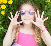 Happy girl at green grass Royalty Free Stock Photo