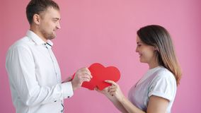 Happy girl and guy exchanging valentine cards smiling feeling love and passion. Happy girl and guy are exchanging valentine cards smiling feeling love and stock footage
