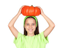 Happy girl in Halloween with a big pumpkin Royalty Free Stock Photography