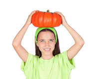 Happy girl in Halloween with a big pumpkin Royalty Free Stock Images